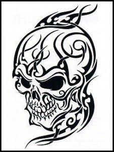 Angry looking skull tribal tattoo. #TattooModels #tattoo