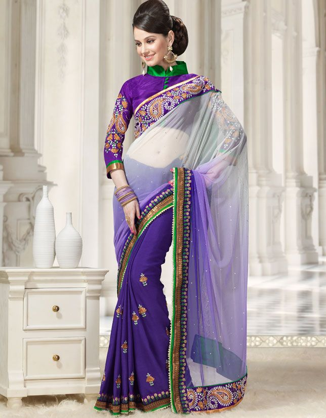 Deep purple and off white faux georgette and net saree with blouse.      Saree is embellished with lace, multi, resham and stones.      Bring out the true Diva in you and reinvent your true self.      Paired with the matching blouse piece. Approx $121.96