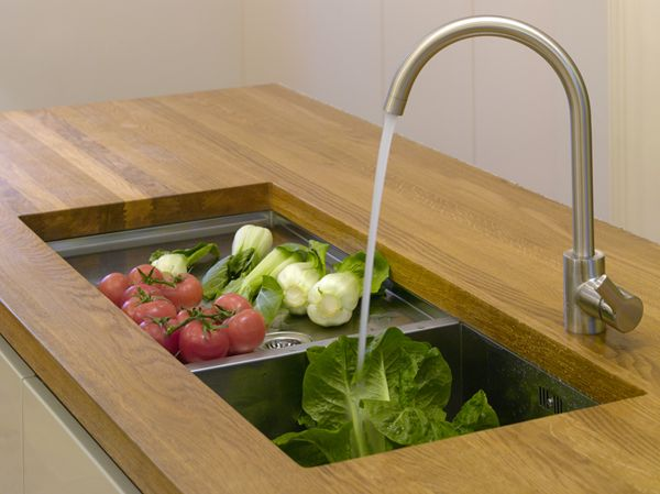 Solid laminated timber benchtop featuring undermounted ...
