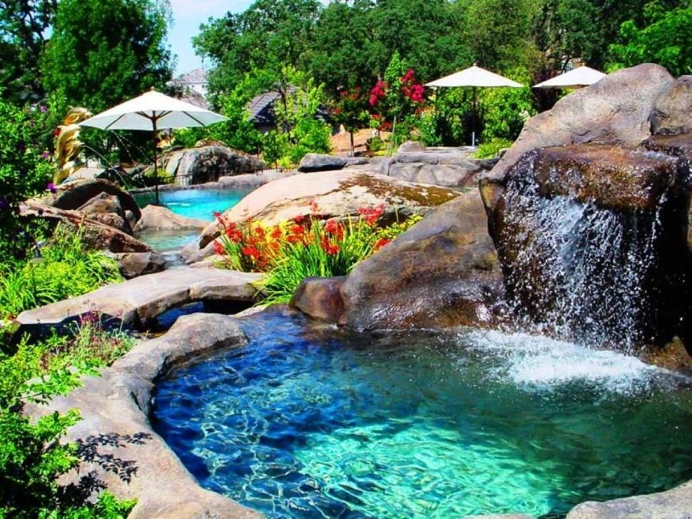 Swimming pool beautiful pool waterfall with decorative for Garden waterfall design