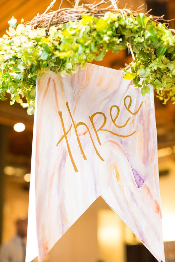 hanging banner table number, photo by Tami Melissa Photography http://ruffledblog.com/the-notwedding-nyc-ii #tablenumbers #weddingideas