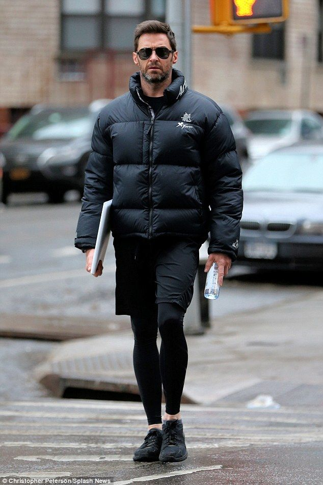 Hugh Jackman, 47, in New York City on Wednesday. Looking in tip-top shape, Hugh opted for a large black jacket to keep warm from the cool American climate as he pounded the rain drenched pavement.