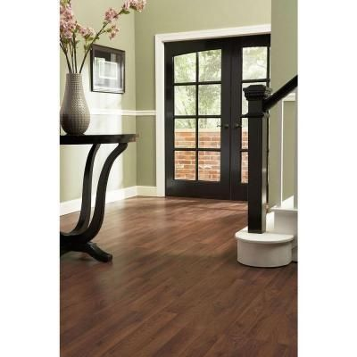 This Laminate Flooring With White Trim Dark Espresso Wood Accents And Green Walls