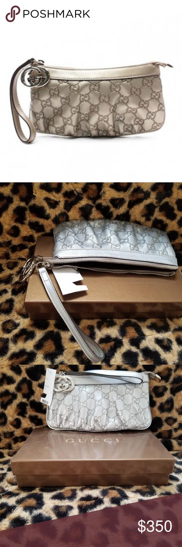 0c2008fdbc7 Gucci Guccissima Silver Britt Metallic Wristlet New in Box Size   Measurements  8.5