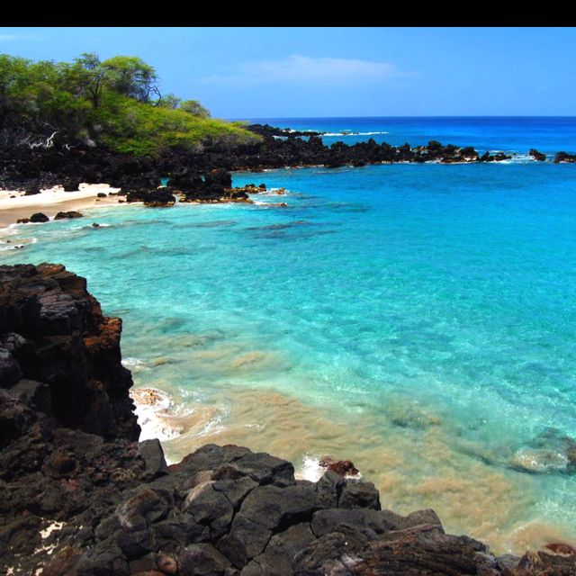 Kona, Hawaii ... white, black, green sand beaches; swimming with turtles; beautiful sunsets; heat; drinks on the beach. <3 here