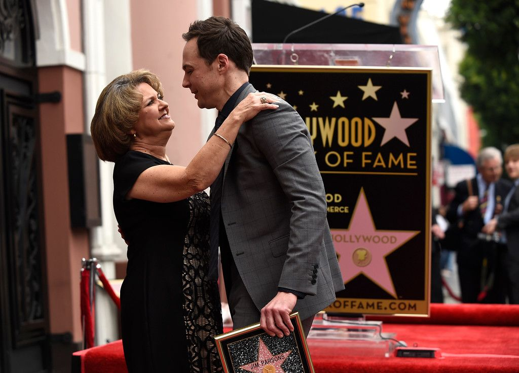 Description of . Jim Parsons, right, with his mother Judy Parsons, is honored with a star at the Hollywood Walk of Fame on Wed., March 11, 2015, in Los Angeles. (Photo by Chris Pizzello/Invision/AP)
