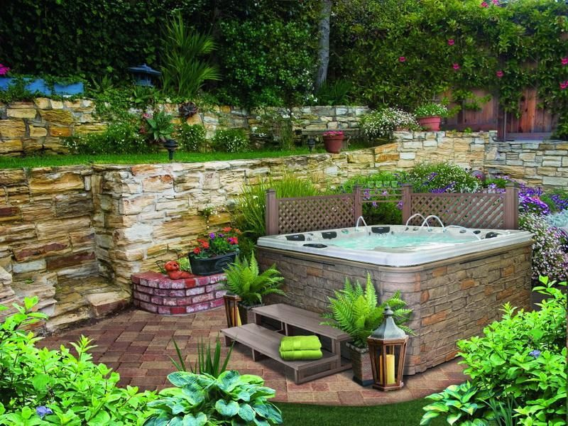 wonderful back yard design ideas designed with wide jacuzzi which has stone frame and brown wooden