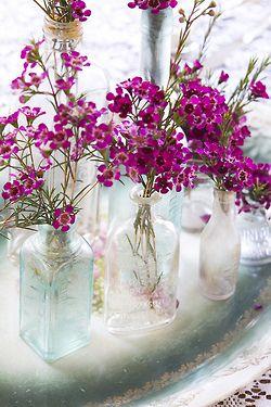 ideas de floreros con botellitas