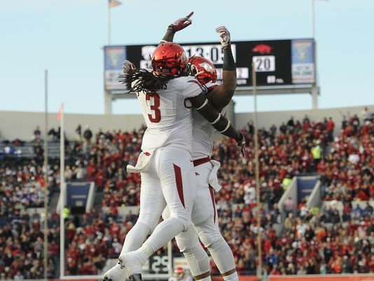arkansas football liberty bowl | Arkansas Razorbacks running back Alex Collins (3) celebrates a ...