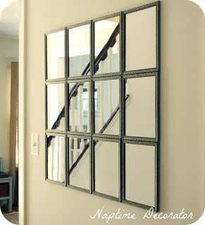 That mirror is actually 12 little mirrors from the dollar store! They are secured individually to the wall by command strips.
