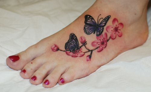 Butterfly S And Cherry Blossoms Real Nice Realistic Colour Work From Ruslan Moshkin At Hammersmith Tatt Butterfly Foot Tattoo Foot Tattoos Flower Foot Tattoo