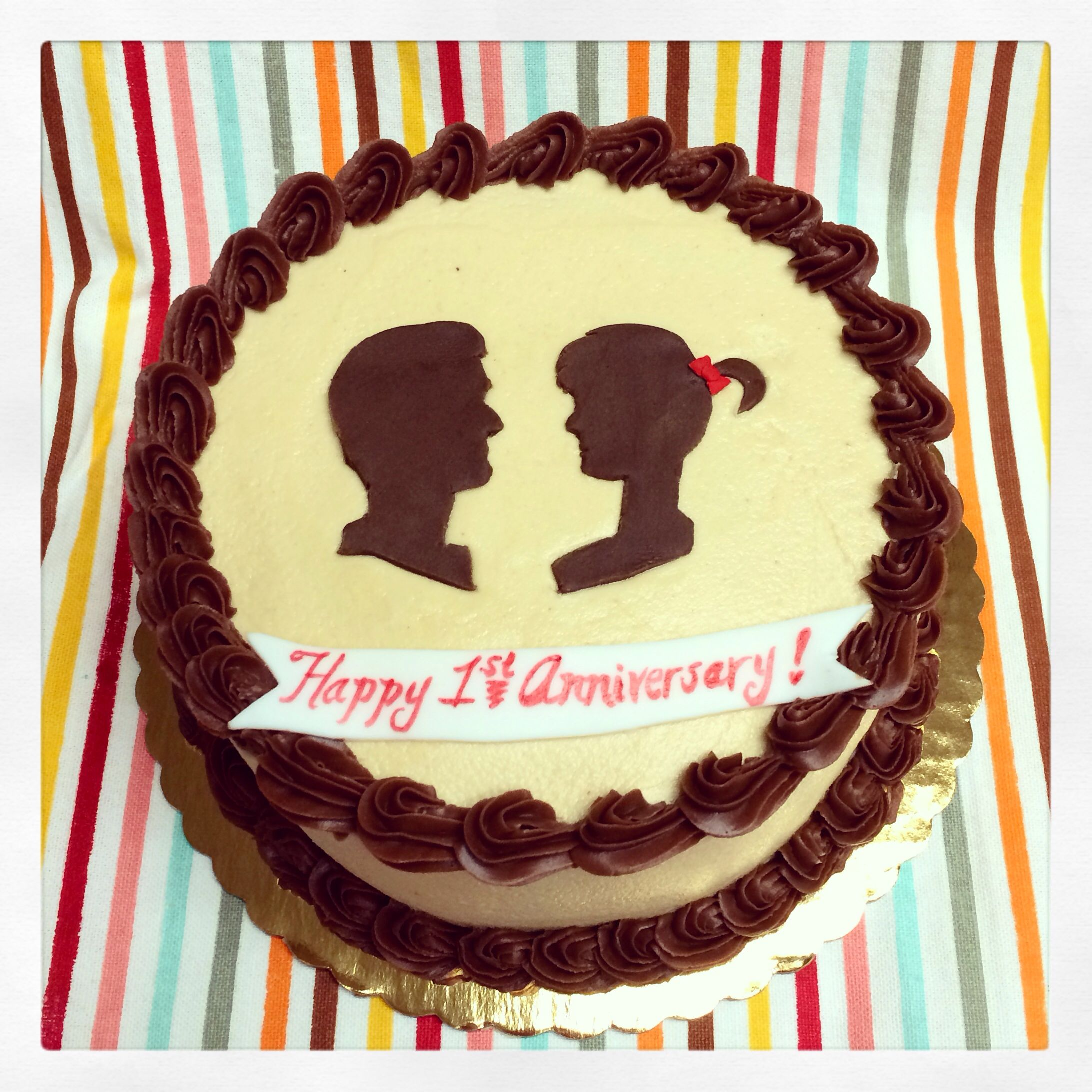 First anniversary cake with silhouettes.