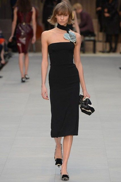 I love the simplicity of this twist on the classic black dress at Burberry.