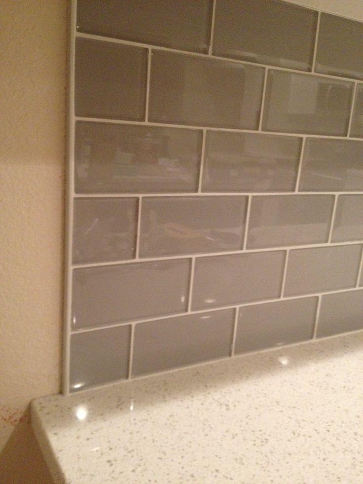 glass tile edging metallic backsplash