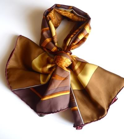 Hermès 'Carré en Carré' scarf with a Classique Grande scarf ring in a pleated bow knot