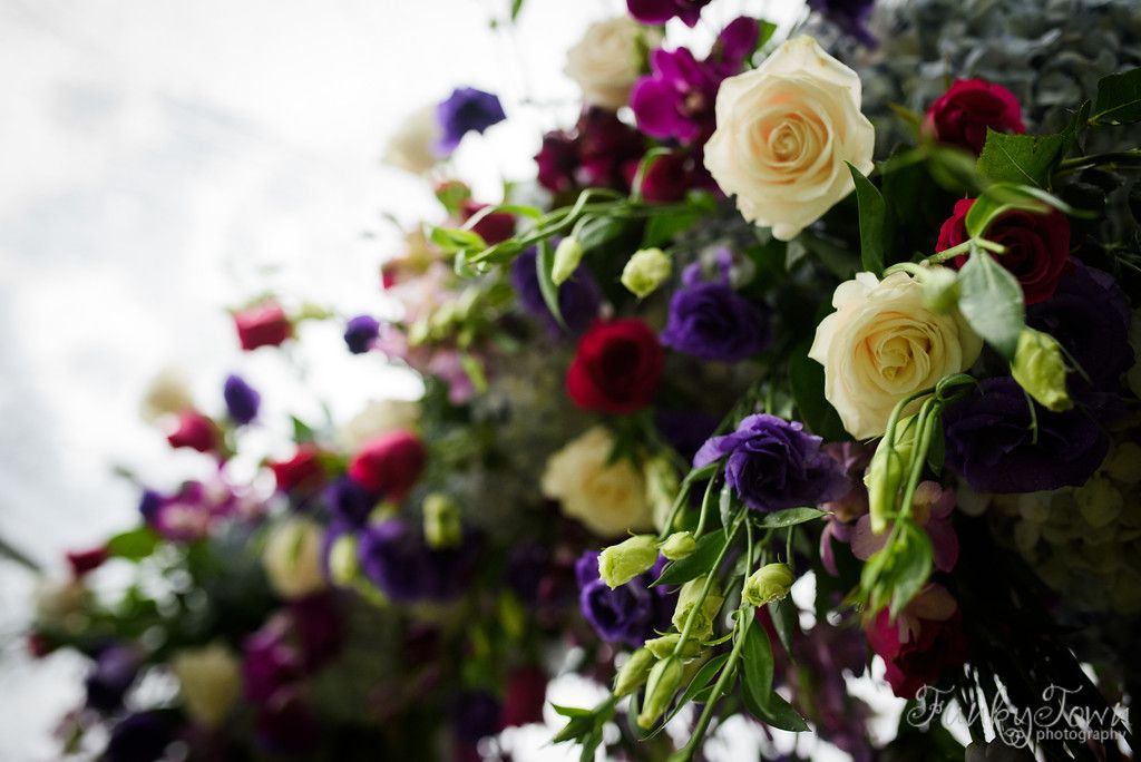 Ceremony arch florals of roses and lisianthus at the