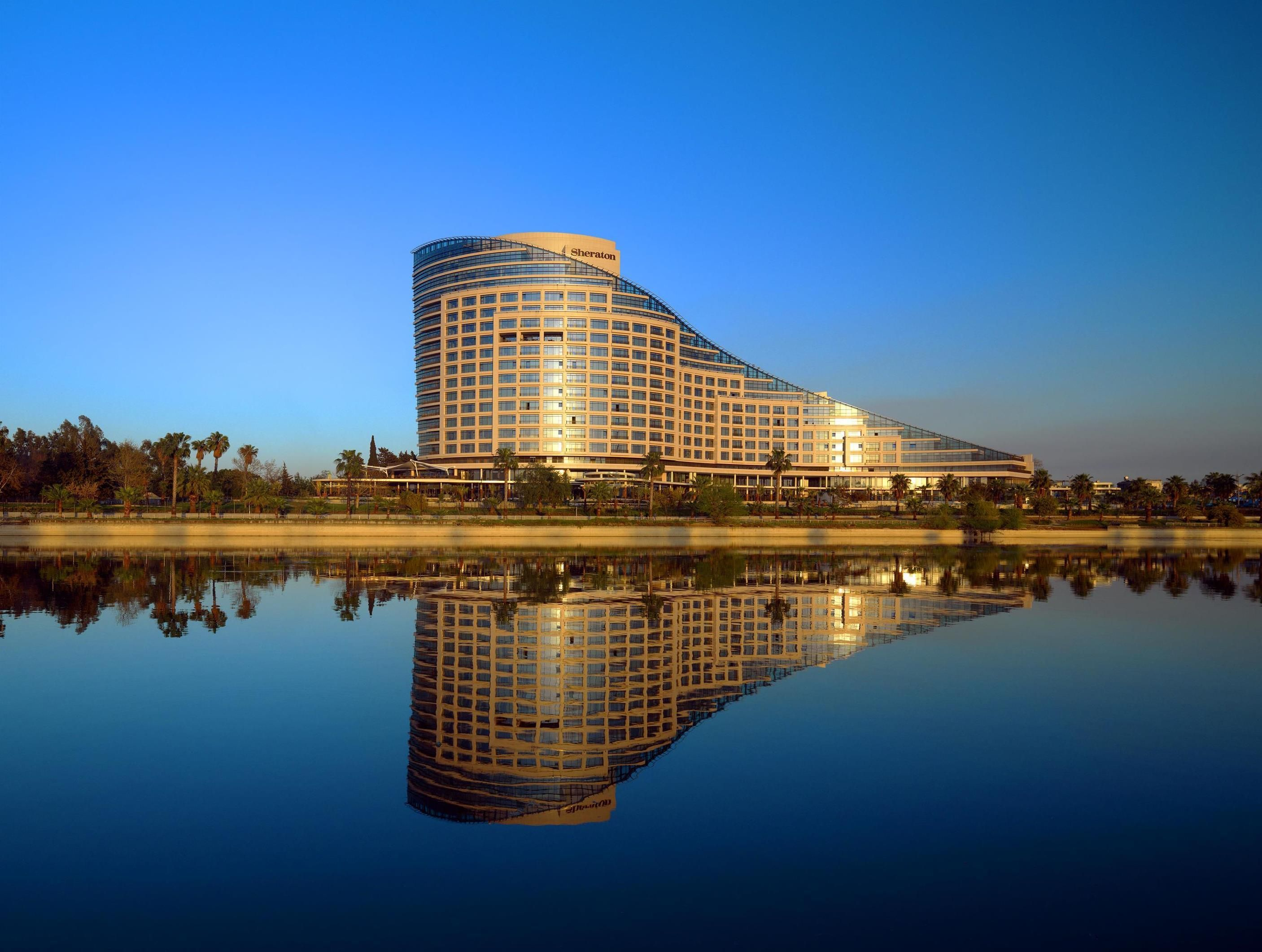 Adana Sheraton Grand Adana Turkey, Europe Stop at Sheraton Grand Adana to discover the wonders of Adana. Both business travelers and tourists can enjoy the hotel's facilities and services. 24-hour security, convenience store, daily housekeeping, fax machine, gift/souvenir shop are on the list of things guests can enjoy. Closet, complimentary tea, dressing room, towels, carpeting can be found in selected guestrooms. Access to the hotel's fitness center, sauna, outdoor pool, ind...