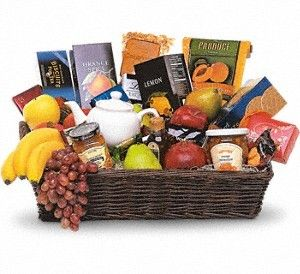"Grande Gourmet Fruit Basket. Ray Hunter Florist & Garden. When you want to send your thoughts in a grande way, send this basket filled with fresh fruit, biscuits and tea. Nothing's grander. ""Approx. 21 1/2"""" W x 13"""" H""   Please note: All of our bouquets and gift baskets are hand-arranged and delivered locally by professional florists. This item may require additional lead time so same-day delivery is not available."