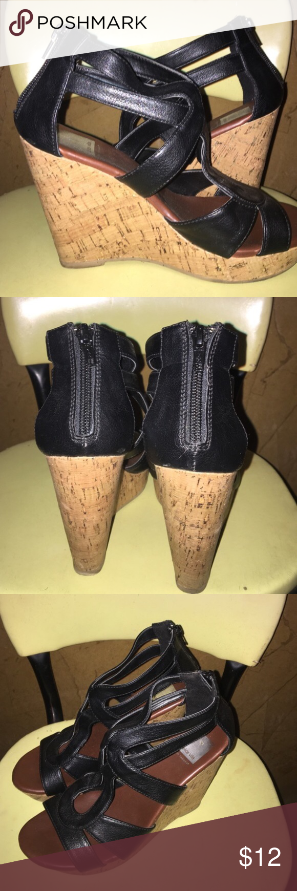 Women's Sz 7 Dolce Vita Black Sandal Wedge EUC Super cute Black wedge sandal. Zips up on back of Sandal.  Super cute wedge that is PERFECT for any Summer  time outfit!  There are zero worn areas on this shoe.  They are in Excellent condition. Dolce Vita Shoes Sandals