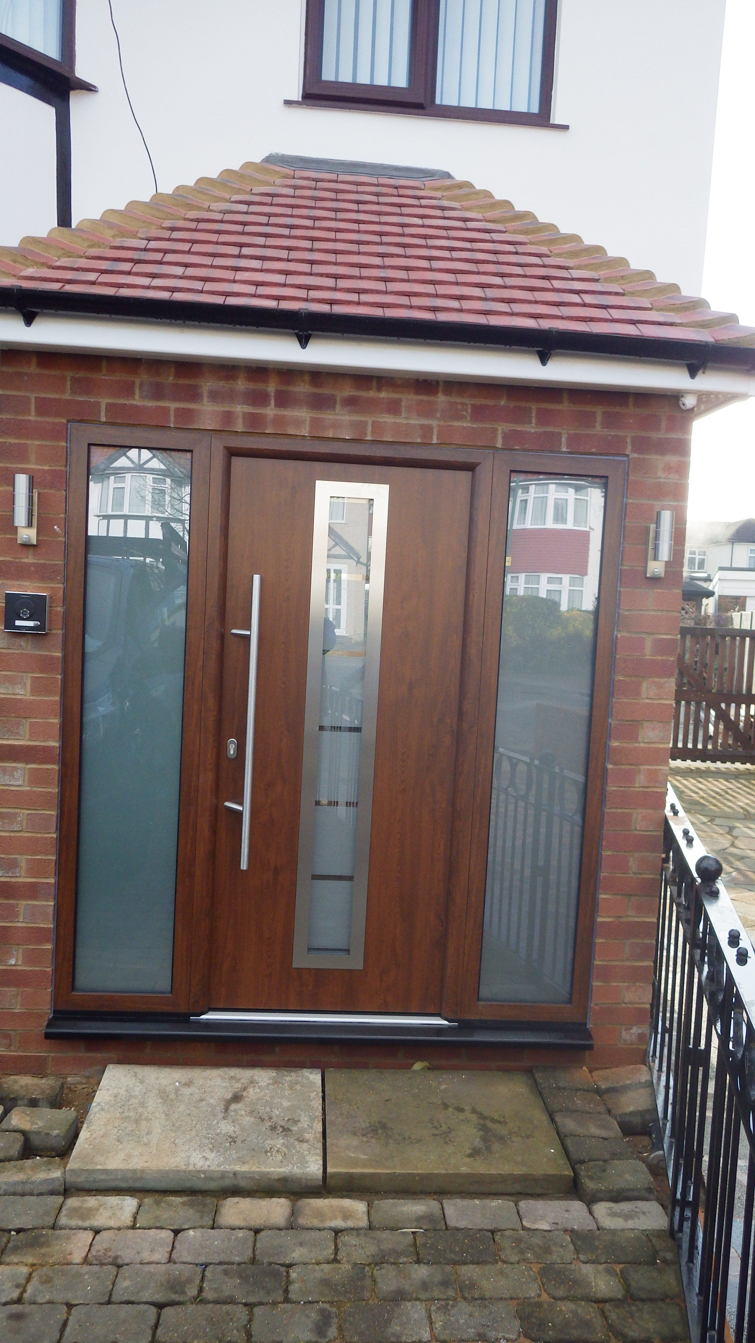 Doors and sidelights matching window on front and black onduline roof - Hormann Steel Thermopro Tps 700 In Dark Oak Decograin Finish