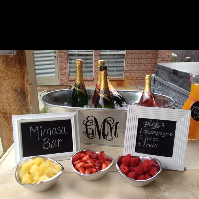 My mimosa bar..LOVE that monogrammed tub! so cute!