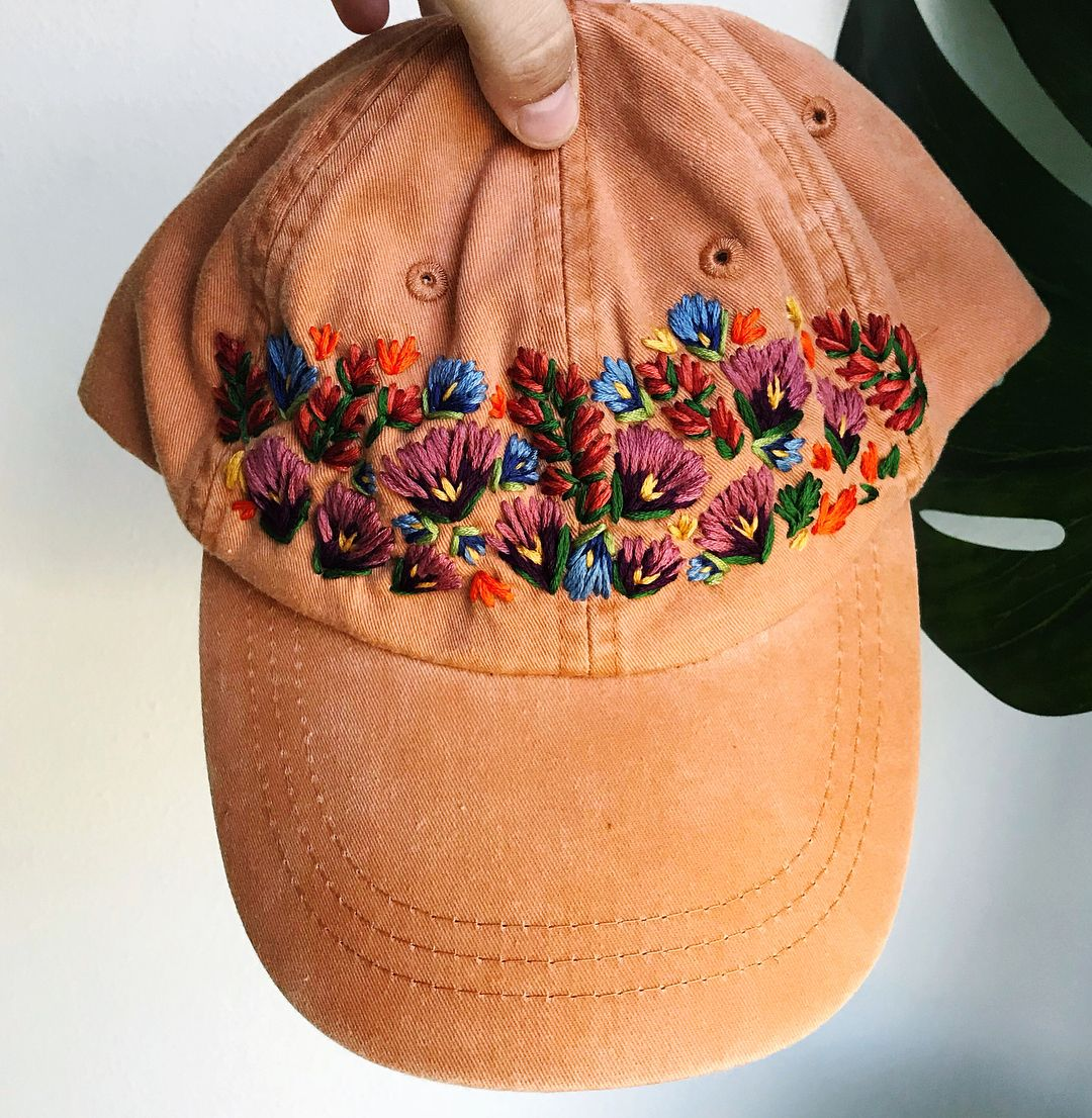 Artist Lexi Mire takes otherwise ordinary ballcaps and adorns them with a  variety of colorful flowers. These are all custom jobs  through Etsy e757141e58c