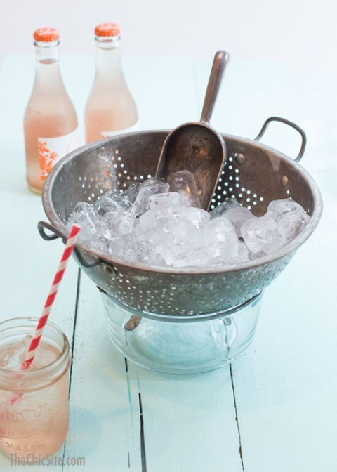 "<p>Water-downed cocktails are <em>not </em>fun at a backyard barbecue. Use a colander as ice buckets so the melty mess can drip away from the ice and guests can fill their glasses with only frozen stuff.</p><p><em><a rel=""nofollow"" href=""http://thechicsite.com/2014/03/27/use-a-colander-as-an-ice-bucket/"">See more at The Chic Site »</a></em><a rel=""nofollow"" href=""http://thechicsite.com/2014/03/27/use-a-colander-as-an-ice-bucket/""></a></p>"