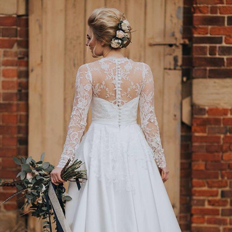Long sleeved illusion back lace wedding dress by Elizabeth Malcolm