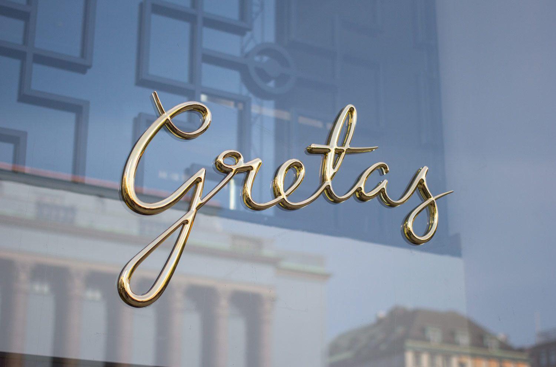 Logotype and signage for Stockholm-based cafe Gretas at Haymarket designed by 25AH, Sweden