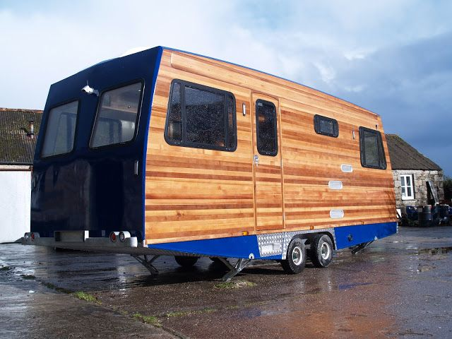what's he building in there? Wood frame custom RV trailer
