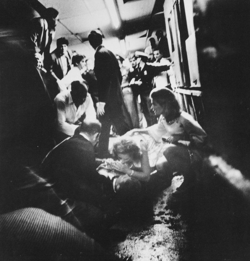 Mrs. Robert Kennedy tries to comfort her husband as he lays mortally wounded on the floor in the kitchen at the Ambassador Hotel. June 6, 1968.