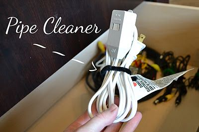 Organize old cords by wrapping them up and tying a pipe cleaner around them