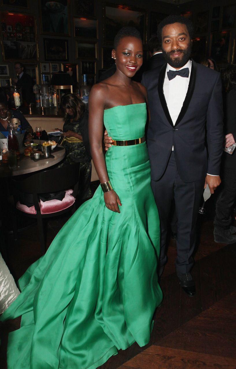Darling of the night, Lupita Nyong'o, #BAFTA nominee for her role in '12 Years a Slave', wore an emerald green @Dior dress accessorised with two Ana Khouri gold cuff #bracelets