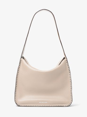 Embellished with polished studs, our Astor hobo is an edgy take on a classic. Cut from pebbled leather, it features a slouchy silhouette and easily stows your phone, wallet, lipstick and more. Carry it from work to weekend with everyday ease.