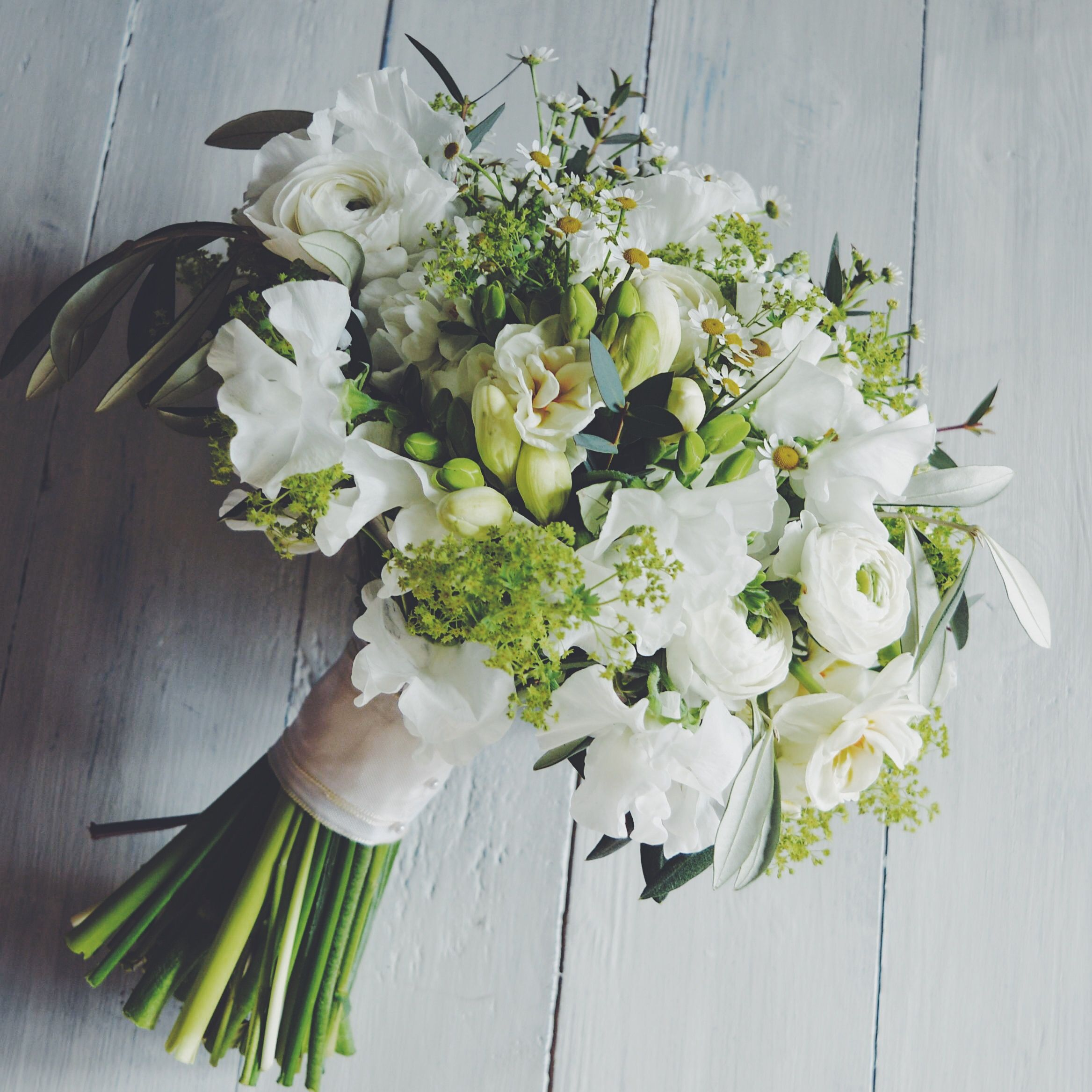 Hand tied spring bridal bouquets in whites created by eden blooms