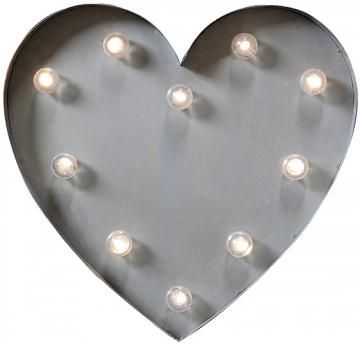 This light-up heart will glow all day and night. Place in the ...