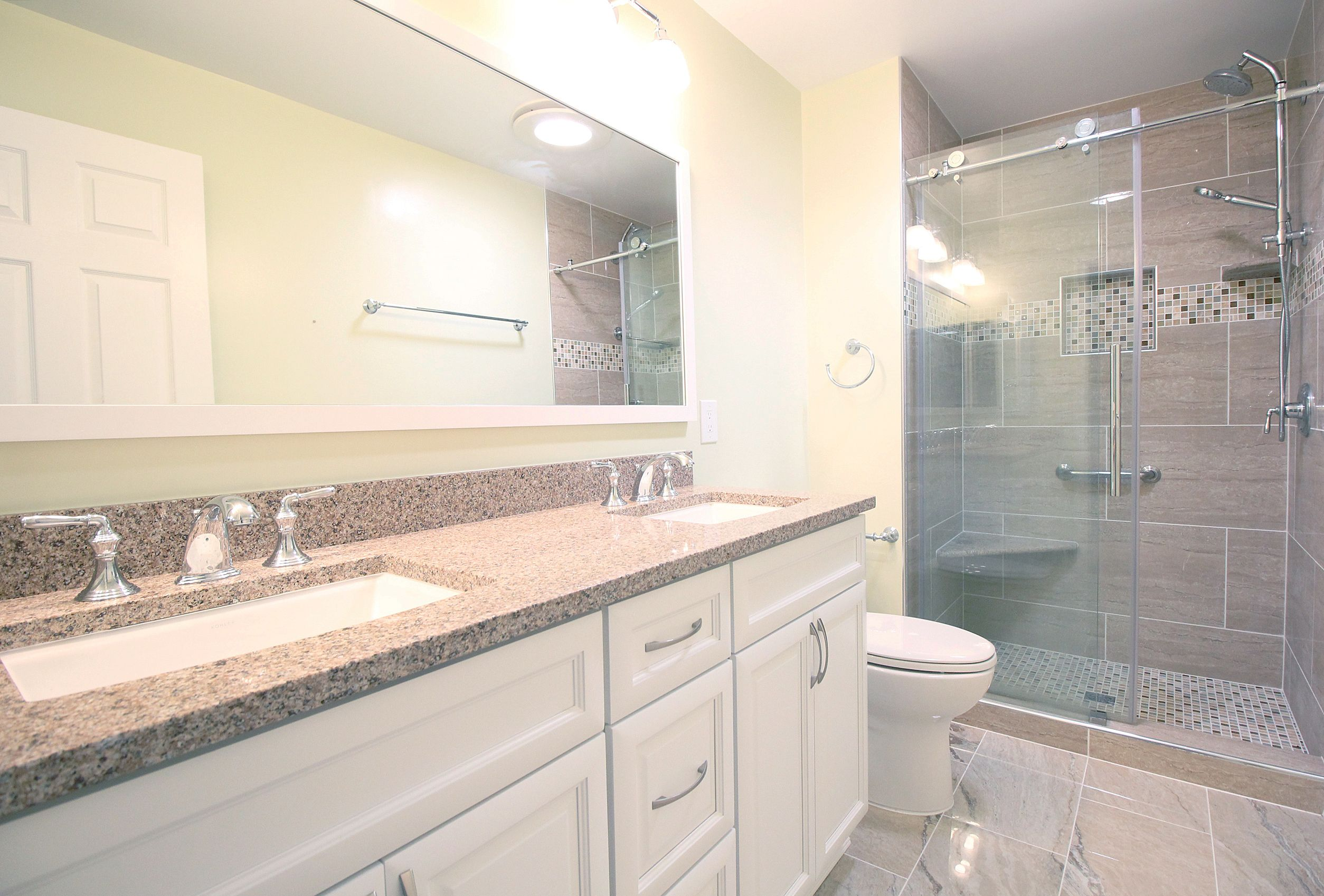 This bathroom features a double vantiy with fauctes from kohler in
