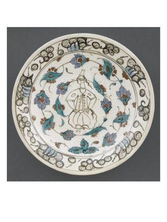 Plat à décor de femme assise et de fleurs  - Musée national de la Renaissance (Ecouen)