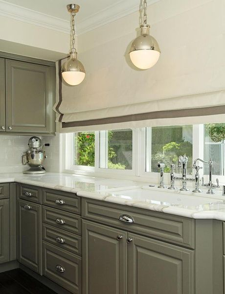 Kitchen with dark wood floors, taupe cabinet, white marble ...