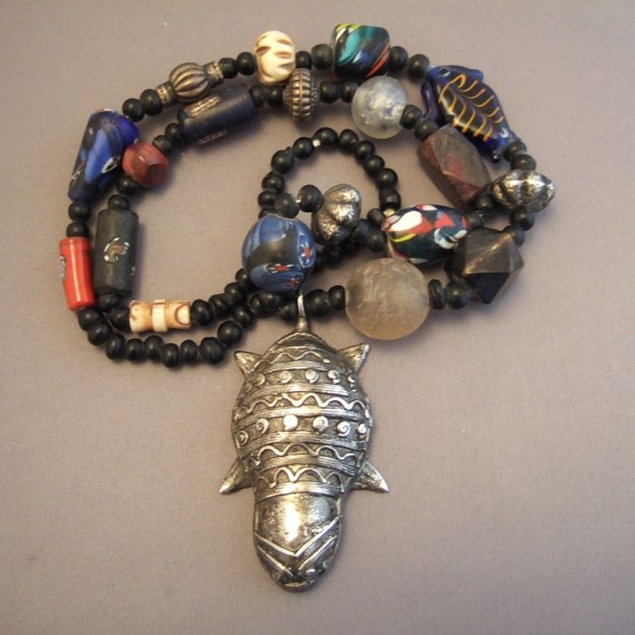 Silver plated metal, ivory, silver, rock crystal, pearls of Venice, wood, ceramics, molten glass, West Africa