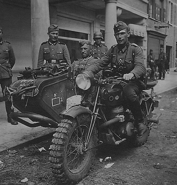 Wehrmacht soldier riding Motorcycle which is probably a Belgian FN.