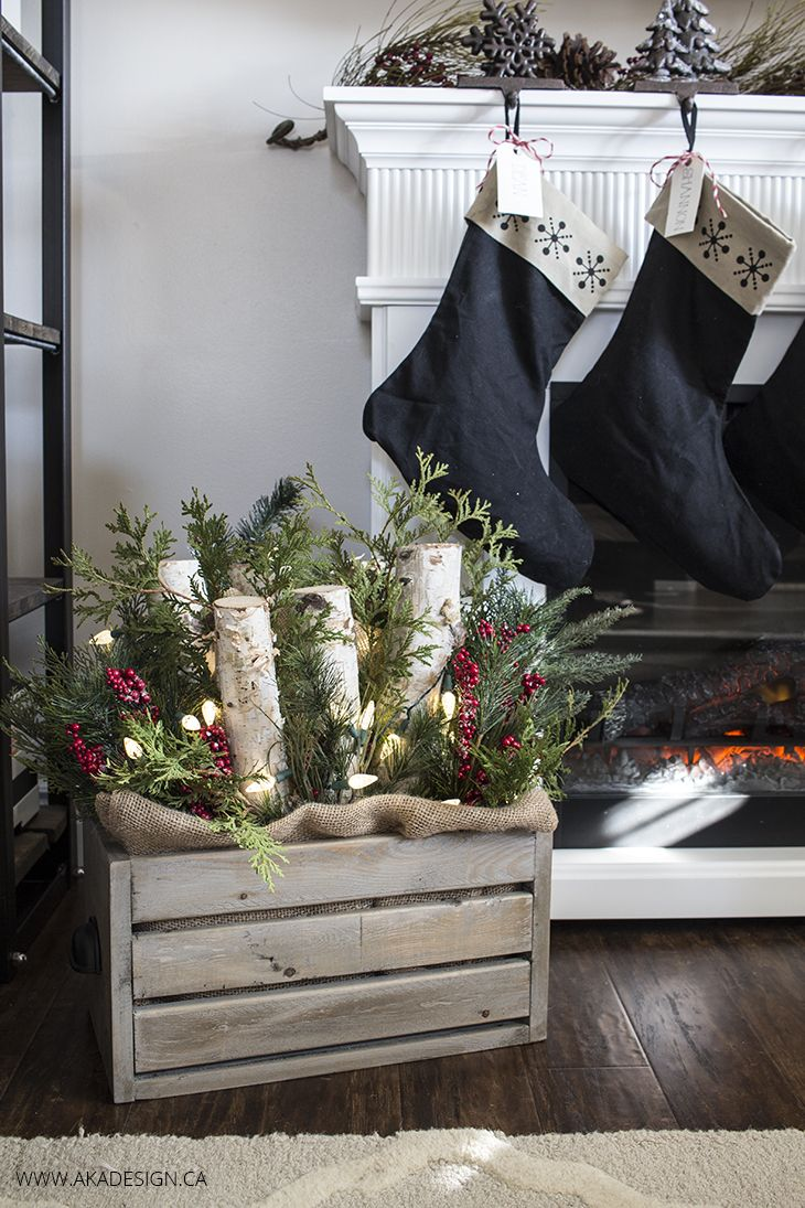 diy wooden crate with logs greenery and lights wooden