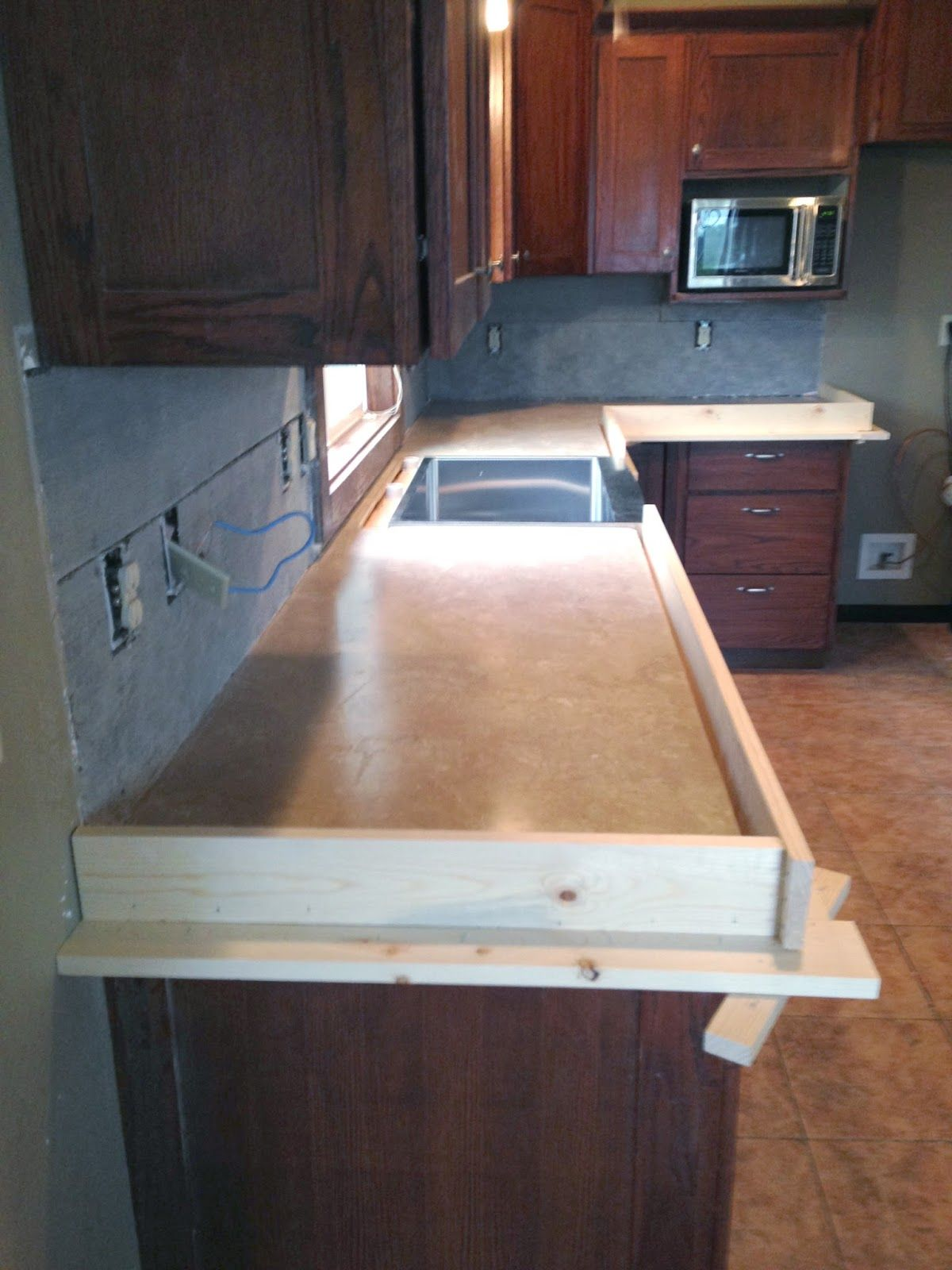 Diy Concrete Counters Poured Over Laminate Diy Countertops Diy Kitchen Countertops Diy Concrete Countertops