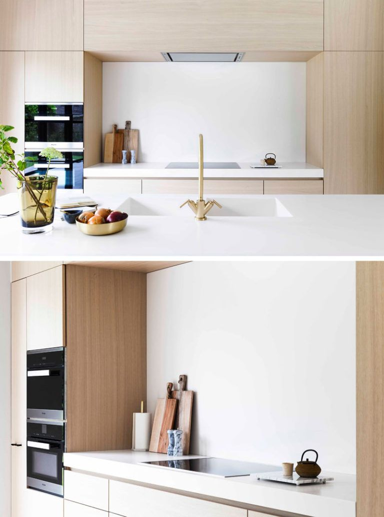 Light Wood And White Countertops Create A Neutral Softness In This Kitchen White Modern Kitchen White Countertops Modern Kitchen Interiors