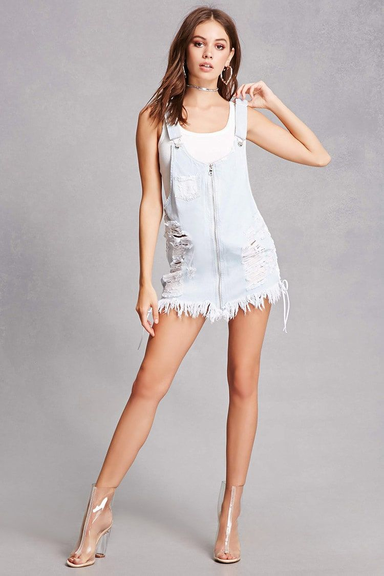 A clean wash denim overall dress featuring distressing laceup