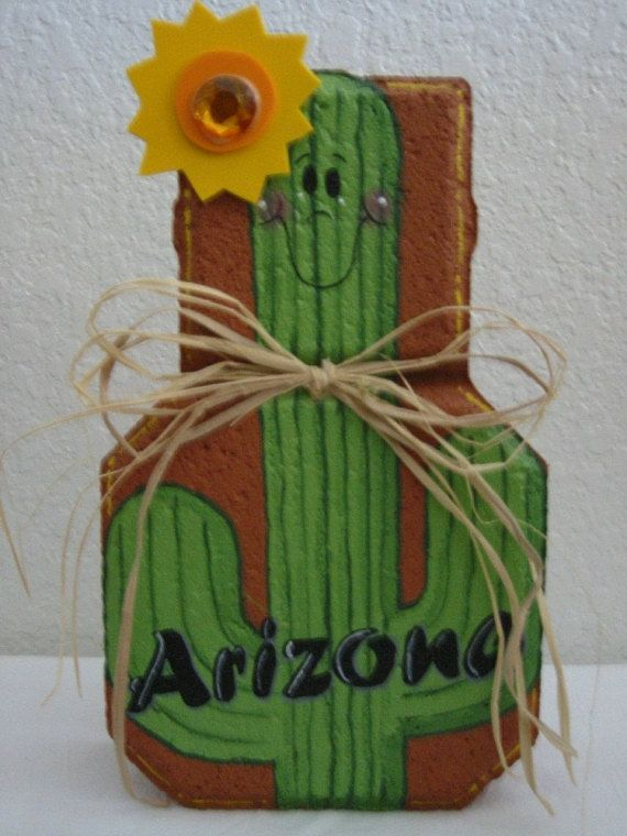 """Yard Art, Garden Decor, Garden Decoration, Outdoor Decor, Arizona Cactus Patio Person Weather Resistant Painted Concrete Paver is part of garden Decoration Concrete - This is one of my Patio People  It is made from a concrete paver and painted with Patio Paint (like everything else I paint) to stand up to the weather  It is very sturdy and definitely isn't one of those outdoor decorations that will blow away with the first gust of wind  The paver itself measures about 9"""" H x 6"""" W x 3"""" D and weighs about 8 lbs  Hats, wings, ears, wood cutouts, other attached items will change those dimensions a bitif you need exact measurements convo me and I'll let you know   These make great outdoor decorations to greet visitors or to dress up a flowerbed, and these are the ones that lots of my customers use for doorstops  They are completely customizable and personalization is free   I have Patio People for every holiday as well as some for specific professions (hairdresser, police, teacher, secretary, etc ) that I will be listing in the near future, please keep checking back, or if there is something you would like to see now please convo me and I'll get on it ASAP    Thanks for your interest and have a great day!"""