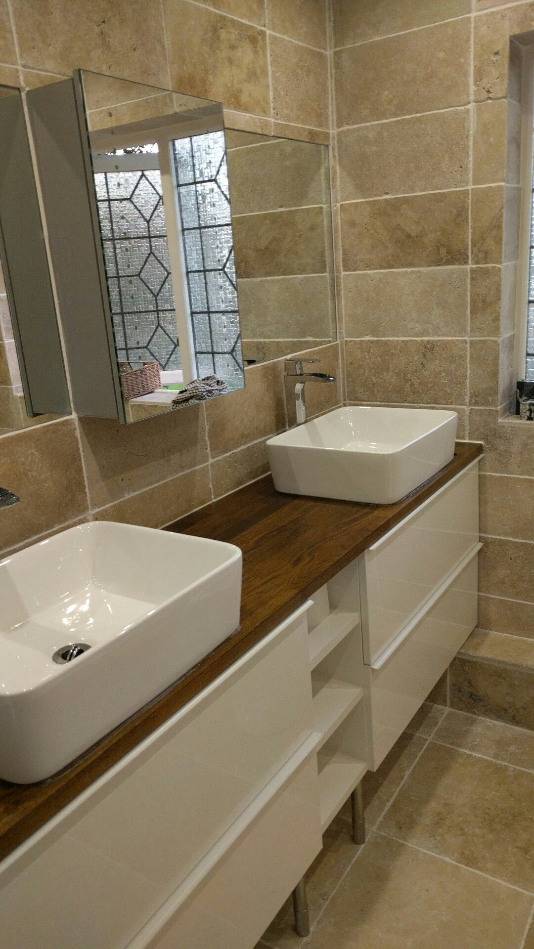 Bathroom is ready! Natural stone travertine tiles, oak worktop and