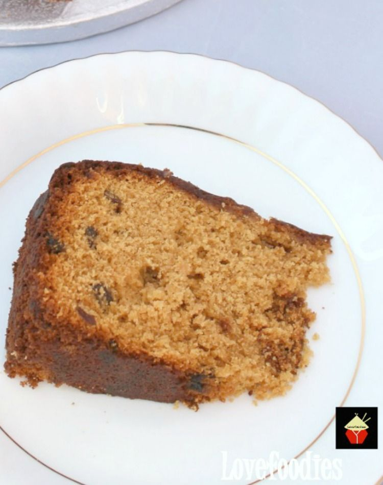 Caribbean Rum Cake. This is a super easy recipe and perfect with a cup of tea to celebrate the holidays! The cake is soft and moist, packed with rum infused raisins and makes for a great Christmas time cake. | Lovefoodies.com