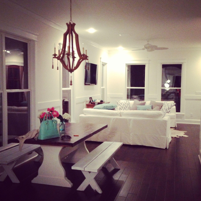 Cowhide rug white cowhide white couches white sofa turquoise pillows ...