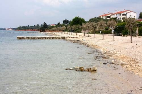 Apartment Biograd na Moru 6159a Biograd na moru Located in Biograd na Moru, this air-conditioned apartment is 25 km from Zadar. The unit is 43 km from Šibenik. Free private parking is available on site.  There is a seating area, a dining area and a kitchen. A TV is provided.